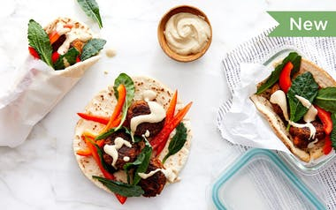 Veggie Meatball Pita Pockets with Baby Kale & Tahini Dressing
